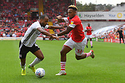 Fulham defender Denis Odoi (4) and Barnsley forward Mallik Wilks (36) during the EFL Sky Bet Championship match between Barnsley and Fulham at Oakwell, Barnsley, England on 3 August 2019.