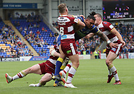 Ben Murdoch-Masila of Warrington Wolves attempts to break through the Wigan Warriors defence during the Ladbrokes Challenge Cup Quarter Final match at the Halliwell Jones Stadium, Warrington.<br /> Picture by Michael Sedgwick/Focus Images Ltd +44 7900 363072<br /> 02/06/2018