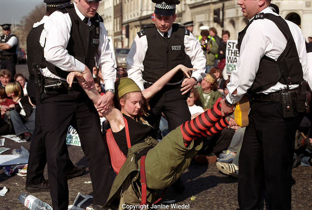 Police removing student protesters from sit down outside Parliament protesting war in Iraq February 2003.