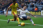 Preston North End Defender Greg Cunningham battles with Rotherham United Midfielder Grant Ward during the Sky Bet Championship match between Preston North End and Rotherham United at Deepdale, Preston, England on 2 January 2016. Photo by Pete Burns.
