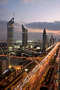 View of Dubai from the Park Place Tower on Sheikh Zayed Road, Dubai (Emirates Towers in foreground). .January 2006, Dubai, United Arab Emirates Archive of images of Dubai by Dubai photographer Siddharth Siva