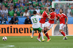 Ashley Williams of Wales clatters both Corry Evans of Northern Ireland and team mate Jonathan Williams of Wales to clear the ball  - Mandatory by-line: Joe Meredith/JMP - 25/06/2016 - FOOTBALL - Parc des Princes - Paris, France - Wales v Northern Ireland - UEFA European Championship Round of 16