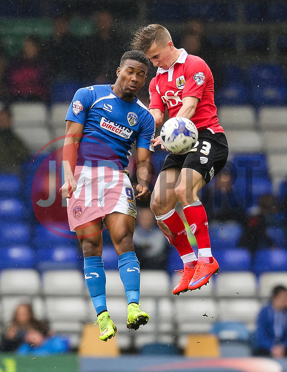 Oldham Athletic's Dominic Poleon challenges Bristol City's Joe Bryan for a header  - Photo mandatory by-line: Matt McNulty/JMP - Mobile: 07966 386802 - 03/04/2015 - SPORT - Football - Oldham - Boundary Park - Oldham Athletic v Bristol City - Sky Bet League One