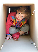 A young 4 year old chaild in a box