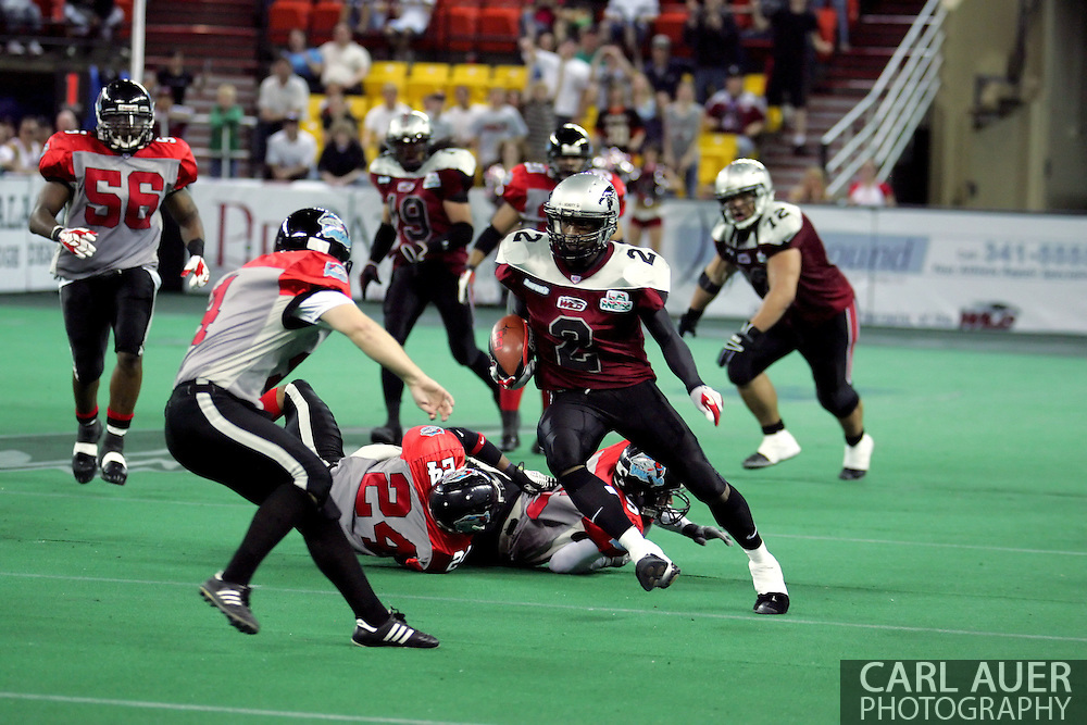6-28-2007: Anchorage, AK - Alaska's Demarcus Morris (3) changes direction to avoid the defense in the Alaska Wild 47 to 53 loss to the CenTex Barracudas at the Sullivan Arena...