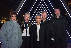 "© Licensed to London News Pictures. 17/01/2018. LONDON, UK. (L to R) Helen Marriage, Lumiere London Artistic Director, Justin Simmons, Deputy Mayor of Culture, Sadiq Khan, Mayor of London, Kasper Rasmussen, Vertigo artists stand in the  ""The Wave"" by Vertigo which is unveiled on the South Bank.  Preview of  Lumiere London, the capital's largest arts festival commissioned by The Mayor of London and produced by Artichoke.  Light installations by leading artists have been set up, both north and south of the river.  Photo credit: Stephen Chung/LNP"