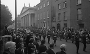 State Funeral Of Mrs Thomas Clarke..1972..08.10.1972..10.08.1972..8th October 1972..Today the state funeral of Mrs Kathleen Clarke took place at the Pro Cathedral,Dublin. Mrs Clarke was the wife of the late Thomas Clarke who was executed in Kilmainham Jail in 1916. Thomas Clarke was a signatory of the Irish Proclamation of 1916..Pictured following the band,the army form a guard of honour as the cortege moves along Marlborough Street.