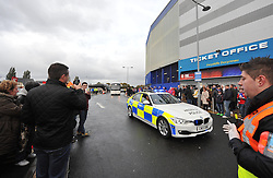 Swansea city coach is escorted  in by a police car. - Photo mandatory by-line: Alex James/JMP - Tel: Mobile: 07966 386802 03/11/2013 - SPORT - FOOTBALL - The Cardiff City Stadium - Cardiff - Cardiff City v Swansea City - Barclays Premier League
