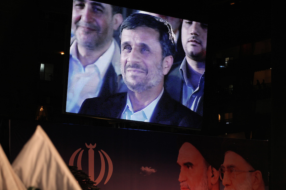 Iranian President Mahmoud Ahmadinejad arrived in Beirut this morning for the start of a two-day trip to Lebanon. After visits around Beirut, Ahmadinejad ended the day by speaking at a Hizballah-organized rally attended by tens of thousands in Beirut's southern suburbs. At the rally, Hizballah head Hassan Nasrallah also addressed the crowd from a video link.///Iranian President Mahmoud Ahmadinejad addresses the crowd in Dahiyeh.