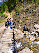Crossing a small bridge over a stream along the Camino Salkantay, Peru.
