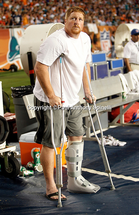 New England Patriots center Dan Koppen (67) checks out the scoreboard while on crutches after sustaining a leg injury during the NFL week 1 football game against the Miami Dolphins on Monday, September 12, 2011 in Miami Gardens, Florida. The Patriots won the game 38-24. ©Paul Anthony Spinelli