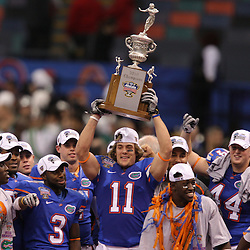 Jan 01, 2010; New Orleans, LA, USA;  Florida Gators wide receiver Riley Cooper (11) holds up the championship trophy in celebration with teammates following a win over the Cincinnati Bearcats in the 2010 Sugar Bowl at the Louisiana Superdome. Florida defeated Cincinnati 51-24.  Mandatory Credit: Derick E. Hingle-US PRESSWIRE.