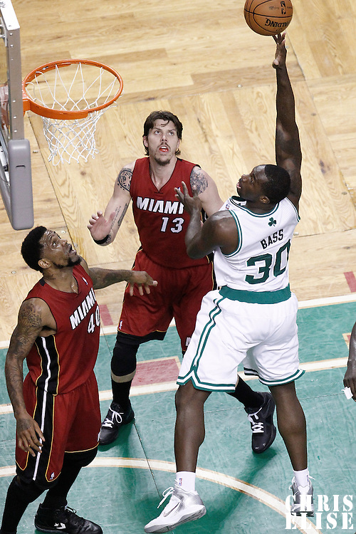 07 June 2012: Boston Celtics power forward Brandon Bass (30) goes for the skyhook over Miami Heat power forward Udonis Haslem (40) and Miami Heat shooting guard Mike Miller (13) during first half of Game 6 of the Eastern Conference Finals playoff series, Heat at Celtics at the TD Banknorth Garden, Boston, Massachusetts, USA.