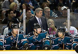 April 16, 2010; San Jose, CA, USA; San Jose Sharks head coach Todd McLellan (top) watches from the bench during the first period of game two in the first round of the 2010 Stanley Cup Playoffs against the Colorado Avalanche at HP Pavilion.  The Sharks defeated the Avalanche 6-5 in overtime. Mandatory Credit: Jason O. Watson / US PRESSWIRE