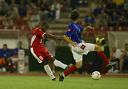 BELGRADE, SERBIA & MONTENEGRO - Wednesday, August 20, 2003: Wales' Nathan Blake gets a shot in under pressure from Serbia & Montenegro's Mladen Krstajic during the UEFA European Championship qualifying match at the Red Star Stadium. (Pic by David Rawcliffe/Propaganda)