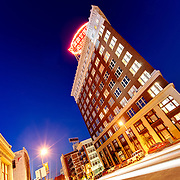 Western Auto Building, downtown Kansas City, Missouri. Wide angle view with traffic motion blur.