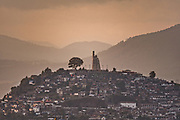 The statue of Jose Morelos dominates the hilltop island of Janitzio at sunset in Lake Patzcuaro, Michoacan, Mexico.