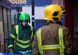 © London News Pictures. 01/12/15. Newscatle, UK. More than 50 fire fighters tackle a blaze in Newcastle city centre today at the Kard Bar on Cross Street. The fire broke out shortly before 9am, with reports of people being trapped on the upper floors. Photo credit: Adam Davies/LNP