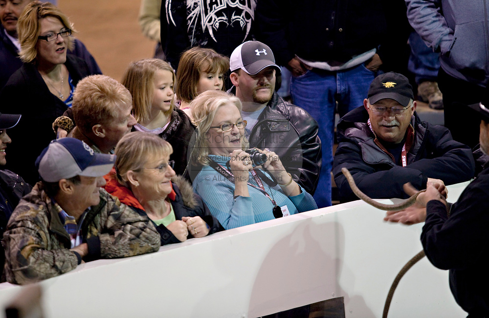 A crowd of onlookers react to a king snake shown by a  Jaycee volunteer snake handler during the 51st Annual Sweetwater Texas Rattlesnake Round-Up March 13, 2009 in Sweetwater, Texas. During the three-day event approximately 240,000 pounds of rattlesnake will be collected, milked and served to support charity.