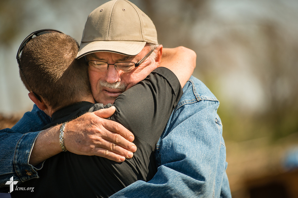 Parishioner Rolan Erck hugs the Rev. Brian Bucklew, pastor at Zion Lutheran Church, after a morning prayer service outside the destroyed church on Tuesday, May 12, 2015, in Delmont, S.D. LCMS Communications/Erik M. Lunsford