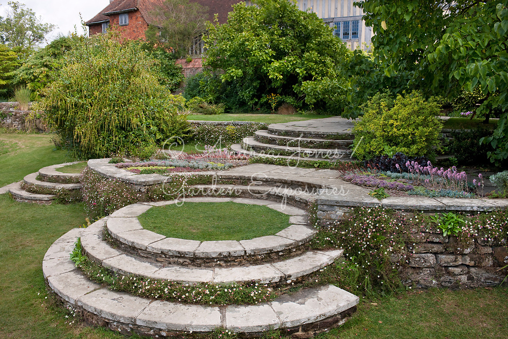 Lutyens circular steps on the Long border with Erigeron karvinskianus and succulents<br /> <br /> Great Dixter House &amp; Gardens, East Sussex, England