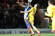 Calvin Andrew is challenged by Jake Cooper during the EFL Sky Bet League 1 match between Rochdale and Millwall at Spotland, Rochdale, England on 21 March 2017. Photo by Daniel Youngs.