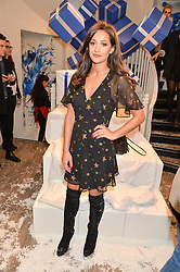 ROXIE NAFOUSI at a party to celebrate 'Kitmas' at Kit & Ace at 80-82 Regent Street, London on 9th December 2015.