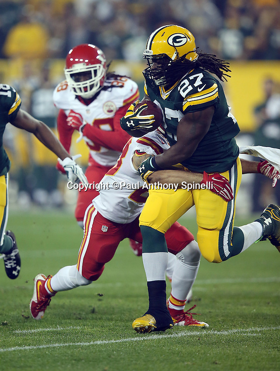 Kansas City Chiefs cornerback Phillip Gaines (23) tackles Green Bay Packers running back Eddie Lacy (27) during the 2015 NFL week 3 regular season football game against the Green Bay Packers on Monday, Sept. 28, 2015 in Green Bay, Wis. The Packers won the game 38-28. (©Paul Anthony Spinelli)