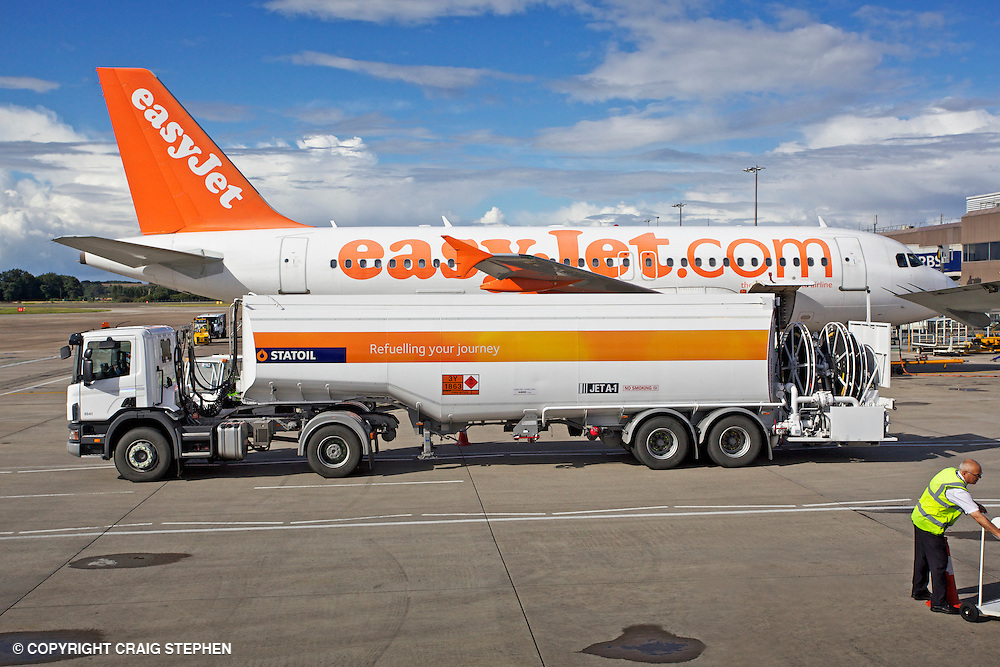 Easyjet plane refueling on the tarmac at Edinburgh airport, Scotland