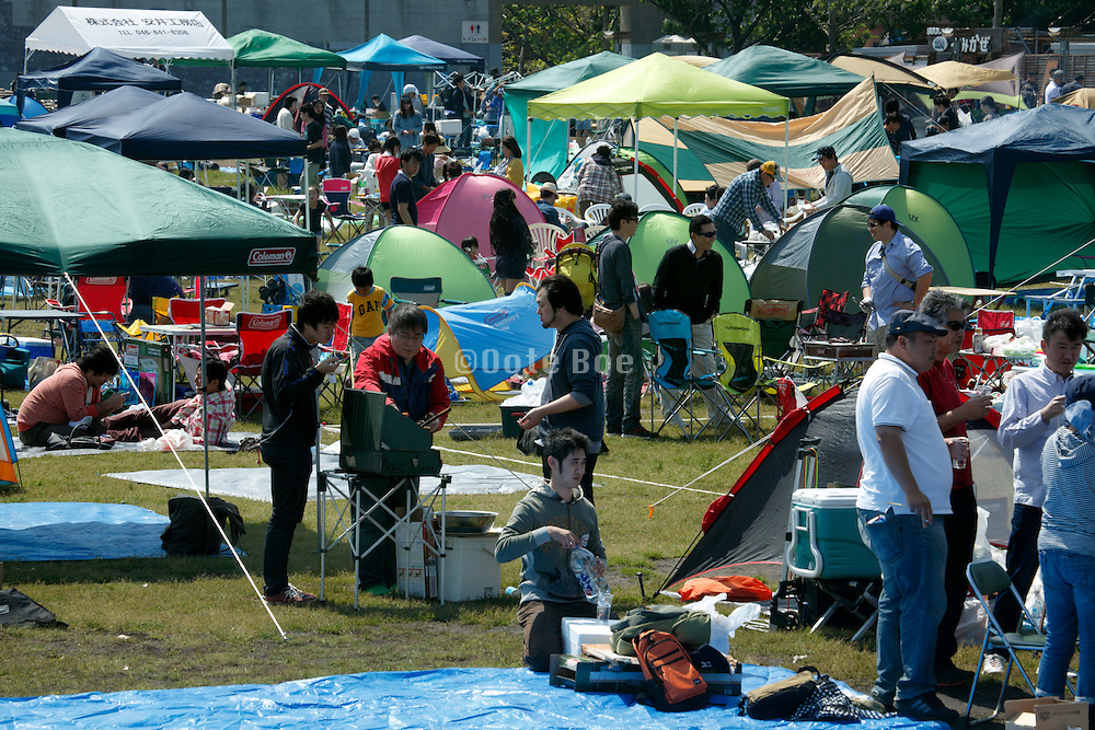 crowded park with picnicking crowd Japan