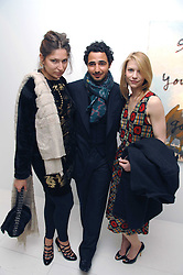 Left to right, STELLA SCHNABEL, ZAC POSEN and CLAIRE DAINES at an exhibition of paintings by artist Rene Richard at the Scream Gallery, Bruton Street, London on 3rd April 2008.<br />