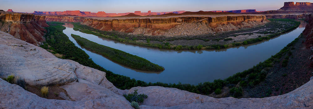 The Green River flows gently below the Candle Stick Camp on the White Rim in  Canyonlands National Park, Utah.