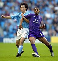Photo. Aidan Ellis.<br />Manchester City v Tottenham Hotspur.<br />FA Barclaycard Premiership.<br />28/09/2003.<br />City's Jihai Sun and Spurs Freddie Kanoute