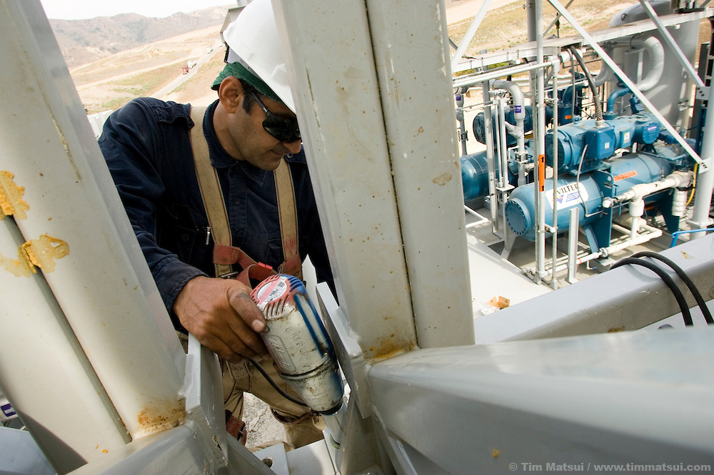 WEDNESDAY JULY 26, 2006 - LOS ANGELES, CALIF.  Bahman Roomiany works on a 5000 gallon per-day methane gas liquifying facility being installed at the Frank R. Bowerman Landfill near Los Angeles in Orange County, Calif. Seattle-based Prometheus will liquify and sell the methane gas for transportation, heating, and industry. The gas is naturally produced by the landfill.