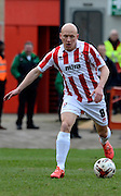 Matt Richards on the ball during the Sky Bet League 2 match between Cheltenham Town and Plymouth Argyle at Whaddon Road, Cheltenham, England on 28 March 2015. Photo by Alan Franklin.