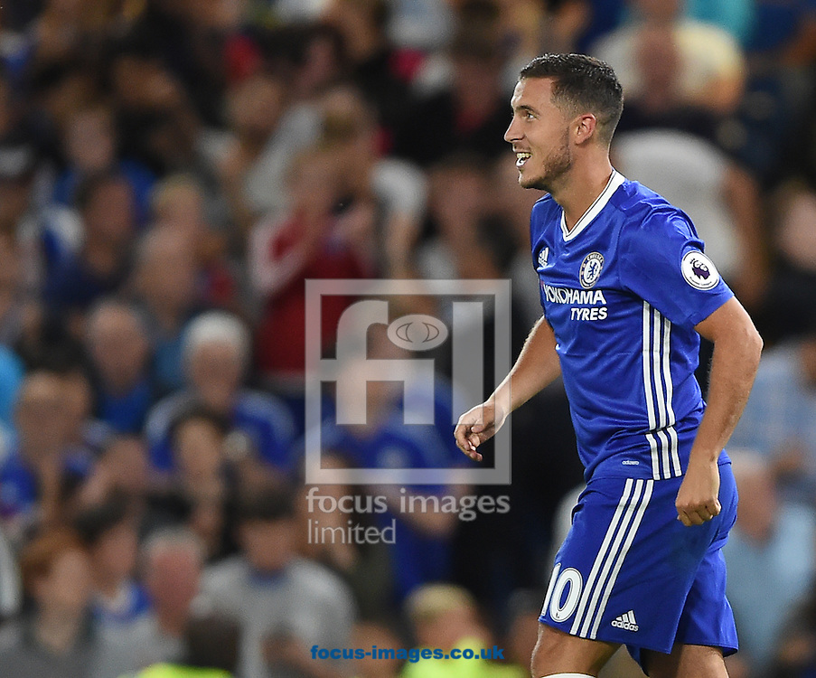 Chelsea's Eden Hazard celebrates scoring their first goal from the penalty spot with Willian during the Premier League match at Stamford Bridge, London<br /> Picture by Daniel Hambury/Focus Images Ltd +44 7813 022858<br /> 15/08/2016