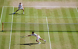 LONDON, ENGLAND - Friday, July 4, 2014: Novak Djokovic (SRB) fails to reach a winning shot from Grigor Dimitrov (BUL) during the Gentlemen's Singles Semi-Final match on day eleven of the Wimbledon Lawn Tennis Championships at the All England Lawn Tennis and Croquet Club. (Pic by David Rawcliffe/Propaganda)
