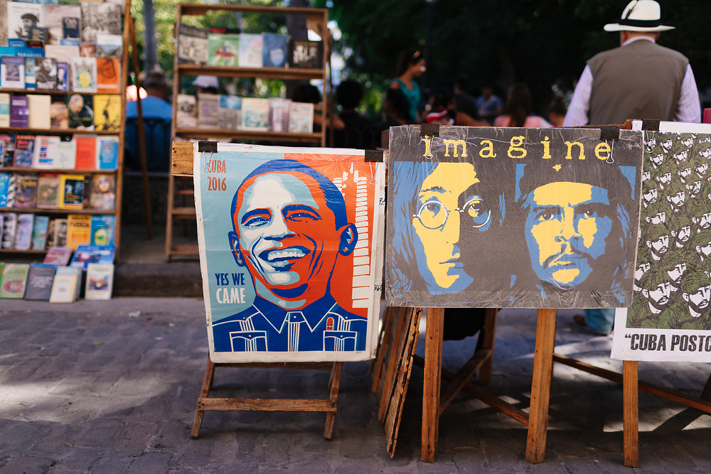 Posters of Obama, John Lennon, and Che Guevara at a flea market in Old Havana, Havana, Cuba