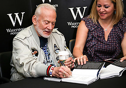 © Licensed to London News Pictures. 04/06/2016. London, UK. Buzz Aldrin signs copies of his new book 'No Dream is Too High' at Waterstone's Piccadilly. Photo credit : Tom Nicholson/LNP