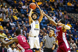 Nov 28, 2018; Morgantown, WV, USA; West Virginia Mountaineers guard Jermaine Haley (10) shoots a three pointer during the second half against the Rider Broncs at WVU Coliseum. Mandatory Credit: Ben Queen-USA TODAY Sports