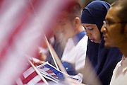 July 4, 2008 -- Phoenix, AZ: A woman from Somalia is surrounded by American flags after she was naturalized as a US citizen at a naturalization ceremony in Phoenix, AZ, Friday. About 300 people from 41 countries were naturalized as US citizens at South Mountain Community College, in Phoenix, AZ, Friday. It was the 20th year the college has hosted the Fiesta of Independence. More than 5,000 people have become naturalized US citizens at the Fiesta of Independence. More than 5,000 people have become naturalized US citizens at the Fiesta of Independence. The largest number of new citizens, 158, came from Mexico. There were also large numbers of new citizens from the Philippines, Bosnia-Herzegovnia and India.  Photo by Jack Kurtz