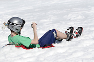 Warwick, New York - A young skier enjoys a warm and sunny day on the slopes while taking pictures of the Big Air Compeitition during the annual Spring Rally at Mount Peter Ski and Ride on March 21, 2010.