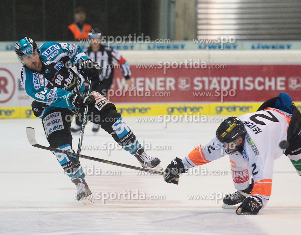 27.09.2015, Keine Sorgen Eisarena, Linz, AUT, EBEL, EHC Liwest Black Wings Linz vs Moser Medical Graz 99ers, 6. Runde, im Bild Dan DaSilva (EHC Liwest Black Wings Linz) scort das 4 zu 2 und Kevin Mitchell (Moser Medical Graz 99ers) // during the Erste Bank Icehockey League 6th round match between EHC Liwest Black Wings Linz and Moser Medical Graz 99ers at the Keine Sorgen Icearena, Linz, Austria on 2015/09/27. EXPA Pictures © 2015, PhotoCredit: EXPA/ Reinhard Eisenbauer