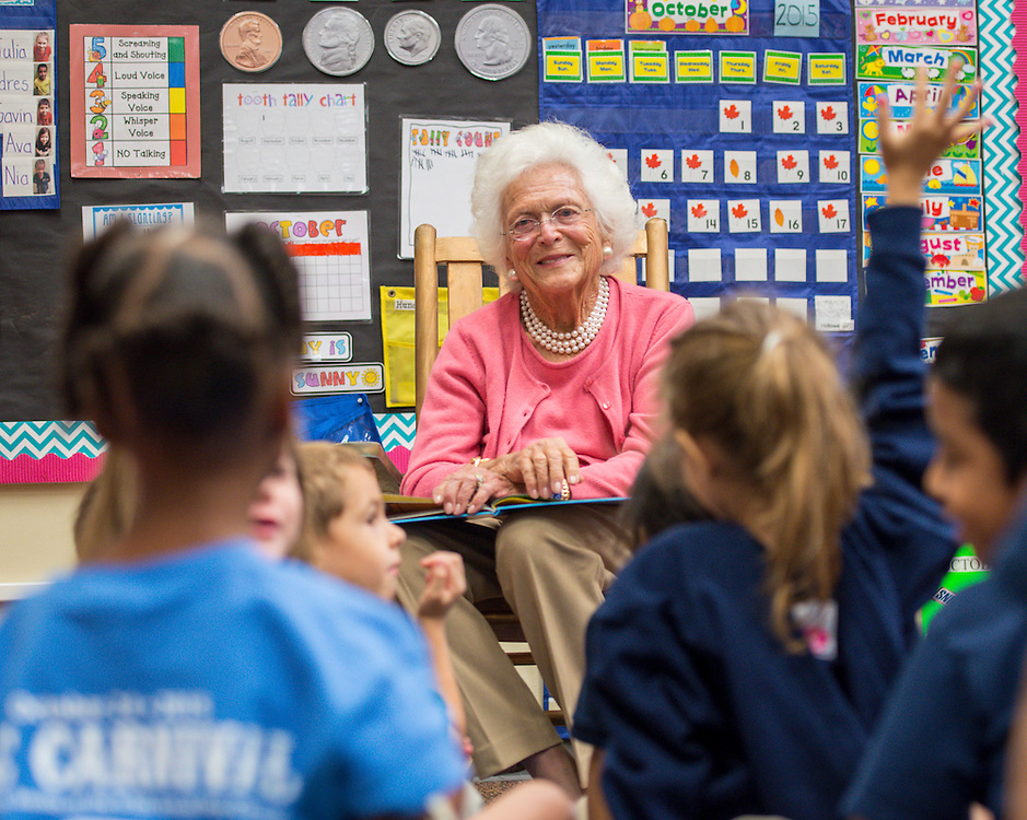 Barbara Bush reads to kindergarteners during the Read Across the Globe event at Poe Elementary School, October 19, 2015.