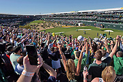 SCOTTSDALE, AZ - FEBRUARY 04: Fans enjoy the action on the 16th hole during the third round of the Waste Management Phoenix Open, at TPC Scottsdale on February 4, 2017 in Scottsdale, Arizona. (Photo by Chris Condon/PGA TOUR)<br /> <br /> There is nothing like the energy at the 16th hole at TPC Scottsdale during the Waste Management Phoenix Open. It is truly a one-of-a-kind event in golf, and not for the timid golf fan!