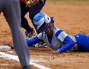 Hampton Lady Pirate Trevonna Byrd makes a ruff dive back into first base during Hampton's doubleheader split against Morgan State at the Lady Pirates Softball Complex on the campus of Hampton University in Hampton, Virginia.  (Photo by Mark W. Sutton)