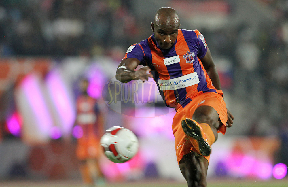 MacPherlin Dudu Omagbemi of FC Pune City takes a shot at the goal during match 44 of the Hero Indian Super League between FC Pune City and Atletico de Kolkata FC held at the Shree Shiv Chhatrapati Sports Complex Stadium, Pune, India on the 29th November 2014.<br /> <br /> Photo by:  Vipin Pawar/ ISL/ SPORTZPICS
