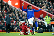 Liverpool midfielder James Milner (7) gets the tackle on Everton midfielder Alex Iwobi (17)  during the Premier League match between Liverpool and Everton at Anfield, Liverpool, England on 4 December 2019.