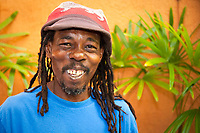 Jamaican man with dreadlocks and big smile