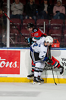 KELOWNA, BC - MARCH 11: Dillon Hamaliuk #22 of the Kelowna Rockets is checked by Will Warm #4 of the Victoria Royals during second period at Prospera Place on March 11, 2020 in Kelowna, Canada. (Photo by Marissa Baecker/Shoot the Breeze)